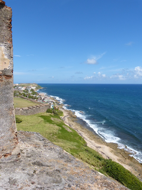A view of the Caribbean Sea from the fort to the west. You can just barely see the lighthouse of El Morro in the distance.