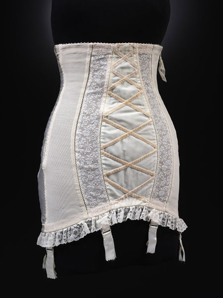COLETTE GIRDLE   - Elastic net and nylon, Satin elastic back panel, with Machine nylon lace and Cotton velvet / 1957-9 Britain (Leicestershire),  R. & W.H. Symington & Co. Ltd , under license from  Chistian Dior,  Paris (V&A:T. 140-2000) * Size - Underbust: 71cm / Waist: 67cm / Hip: 91cm / Length front: 46cm / Back: 50cm  Given by Caroline Wren