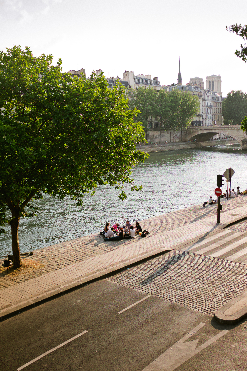 Picnic along Seine in    Paris, France by Seattle based photographer Dylan Priest