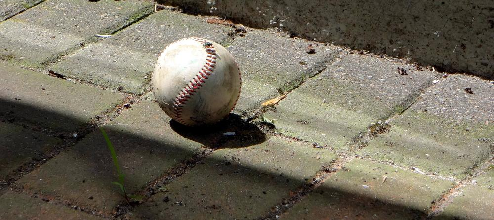 baseball-on-cement-on-the-ground