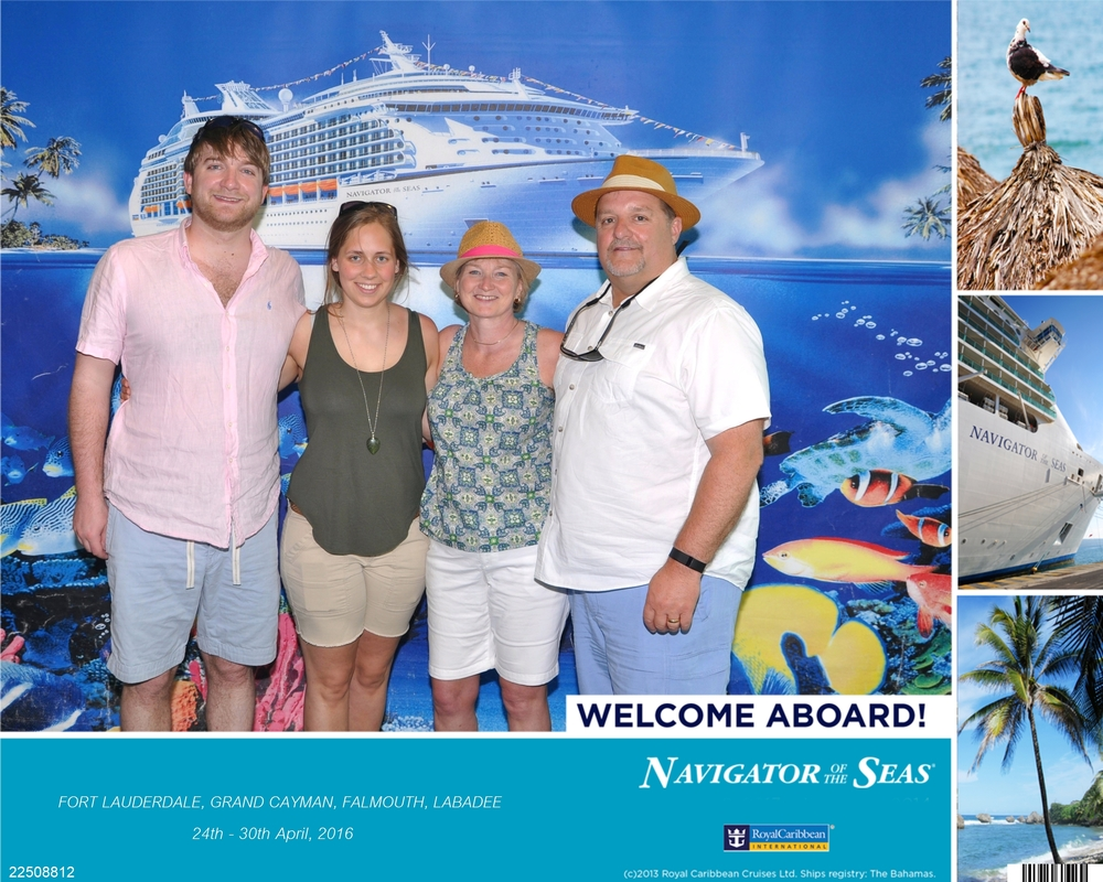 This is the moment we stepped on the cruise ship, and they made us stop and have our picture taken. You can see all of the cruise info, the ship, name, the dates, and everything.
