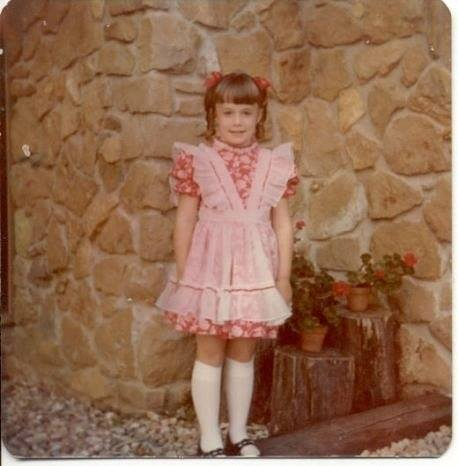 Age 6, dressed up in a costume for her first ever musical, Babes in Toyland.