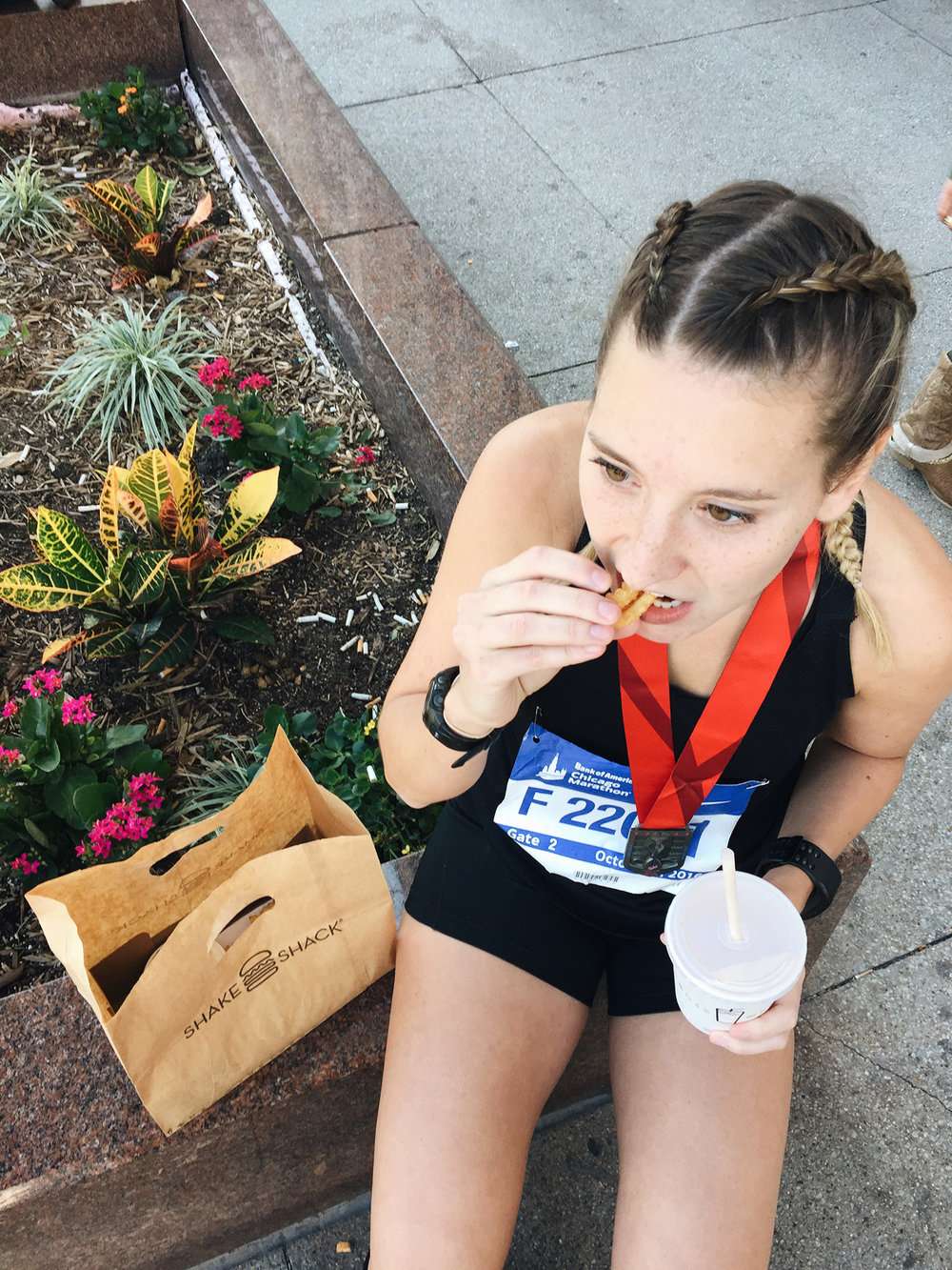 CAUGHT NOSHING ON A BASKET OF CRINKLE CUT FRIES AND A BLACK AND WHITE SHAKE FROM SHAKE SHACK POST RACE.