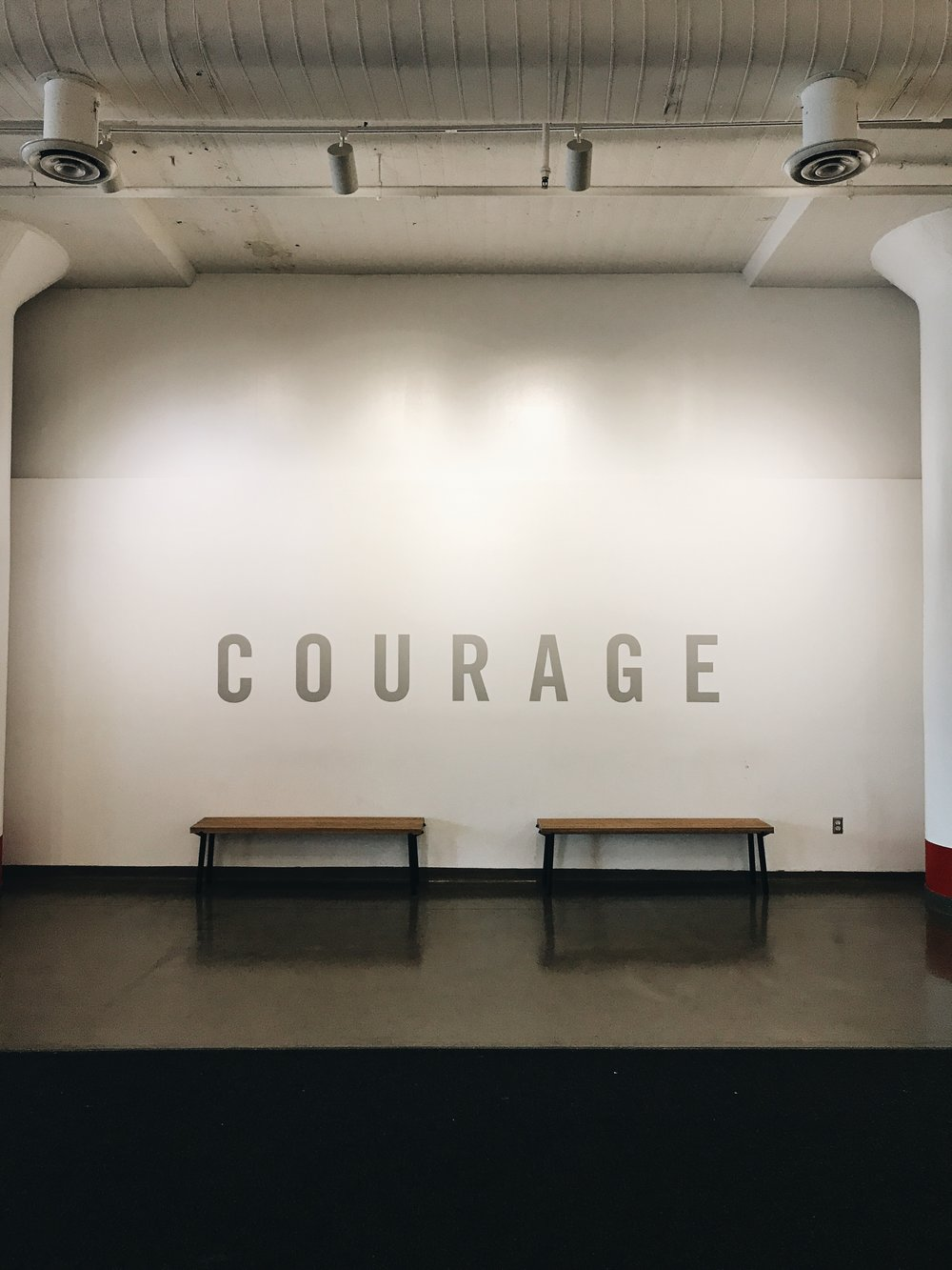 MY TRAVELS BROUGHT ME TO THE FACTORY LOCATED IN LONG ISLAND CITY, ABOUT A 10 MINUTE WALK FROM THE COURT SQUARE DINER. THE INTERIOR DESIGN OF THE LOBBY APPEALED TO ME GREATLY, THIS WALL IN PARTICULAR. I COULDN'T HELP BUT SNAP A PIC AND THINK OF THE MANY QUOTES THAT EXIST ABOUT COURAGE, ONE OF MY FAVORITE WORDS. ONE STOOD OUT IN PARTICULAR, SAID BY A FAVORITE NOVEL CHARACTER, ATTICUS FINCH...