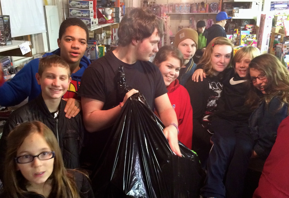 Youth volunteering at Toys For Tots to select and package Christmas presents