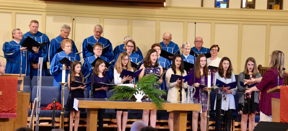 Senior and Youth Choirs sing together in worship.