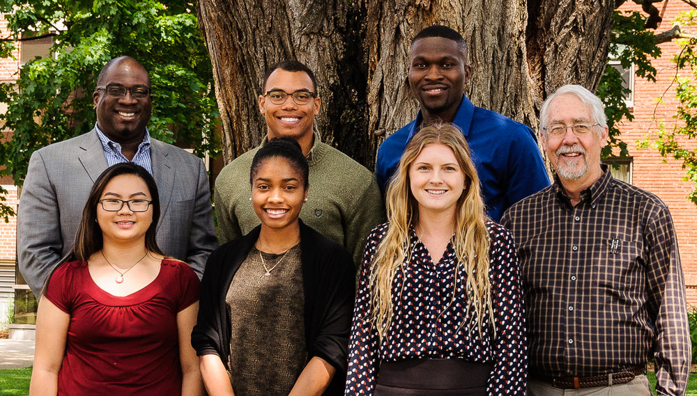 Top Row Left to Right: Marcus Winbush, Collin Kange, and Olaoluwa Awoleke.  Bottom Row Left to Right: Rita Bernardo, Nikaylah Woody, Emily Glaser, and Craig Britton.