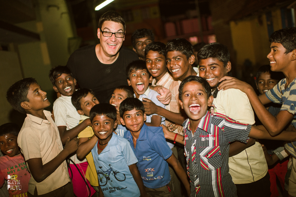 Curt Vernon and kids in an indian village (photo by  dei gratia photography