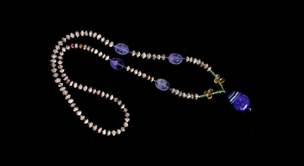 Betal Nut, Amethyst, Peridot, Citrine and Purple Banded Agate Mala   6mm Betal Nut beads with Amethyst chunks, Peridot rondels, Citrine briolettes, and a purple banded Agate guru bead
