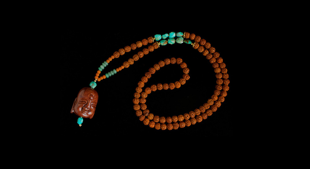 Rudraksha and Turquoise with CarvedBuddhaHead Mala   8mm Rudraksha seed beads and Turquoise nuggets with a large wood carved Buddha head