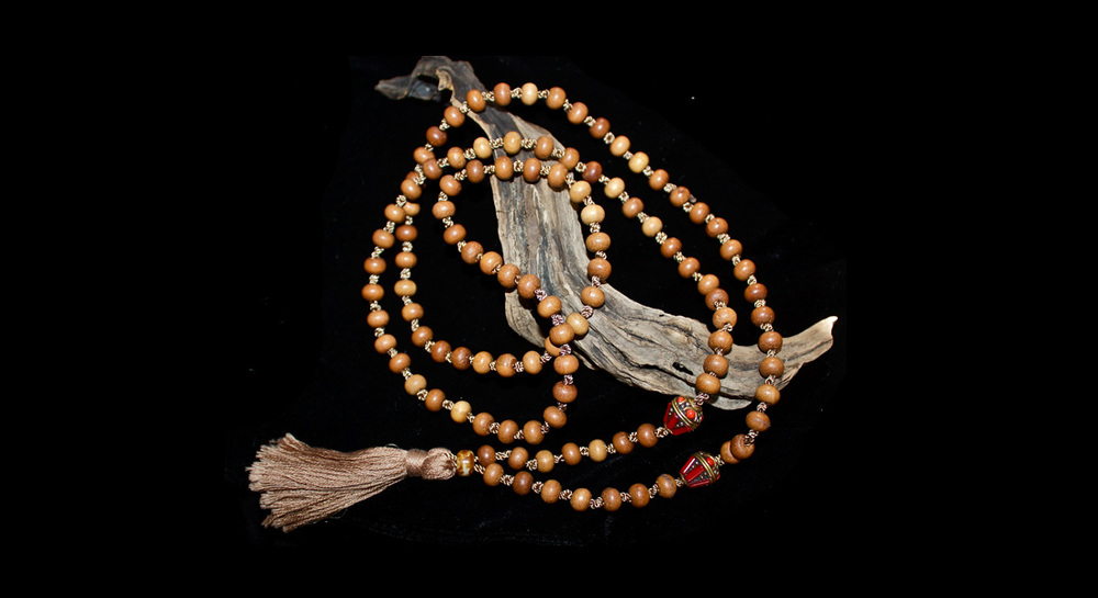 Wood and Tibetan Beads with Tassel Mala   8mm Wood beads and Coral inlay Tibetan beads with a tassel