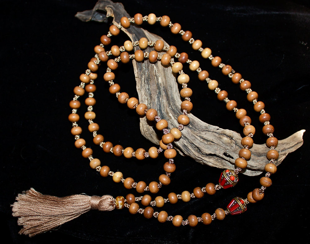 wood-and-tibetan-beads-with-tassel-mala.jpg