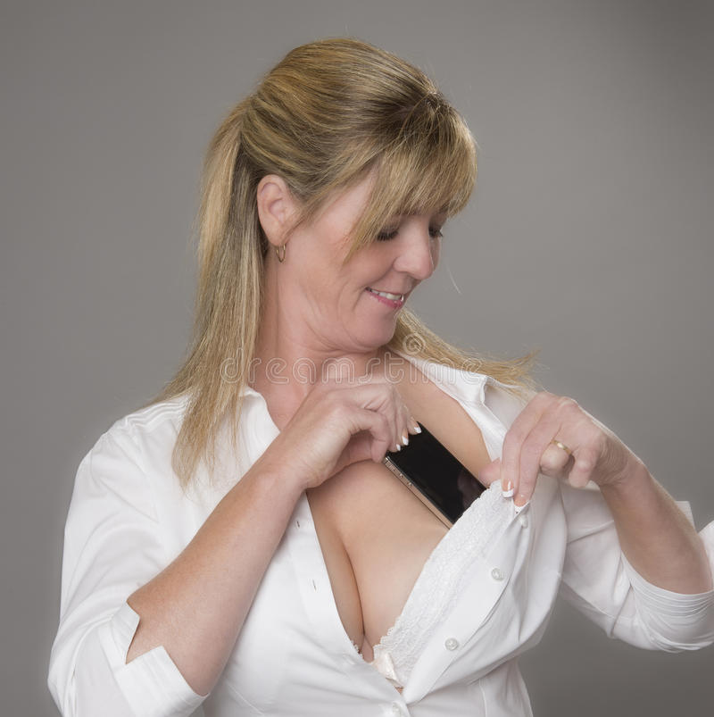 woman-placing-phone-her-bra-tucking-mobile-white-safety-female-removing-to-receive-call-53920398.jpg