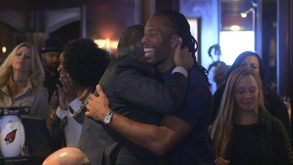 Wide receiver Larry Fitzgerald enjoys the event and receives a hug.