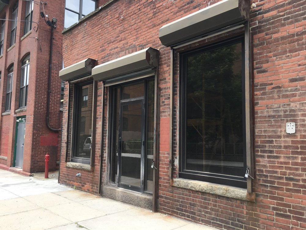 Motion Center Yoga is the storefront pictured above. It is adjacent to a 3 story Mill, 80/84 Fountain Street in Pawtucket, RI.