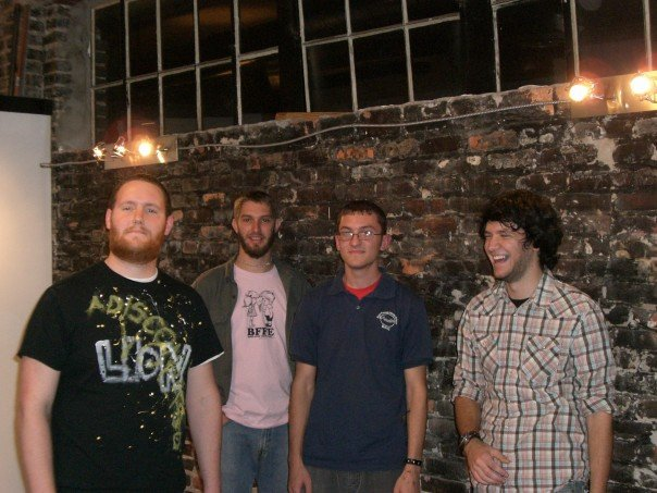 Original Prisms lineup, pictured at Relative Theory Records, December 2006.    From left: Nick Huber, John Martin, Nathan Mitchell, Sam Hurd