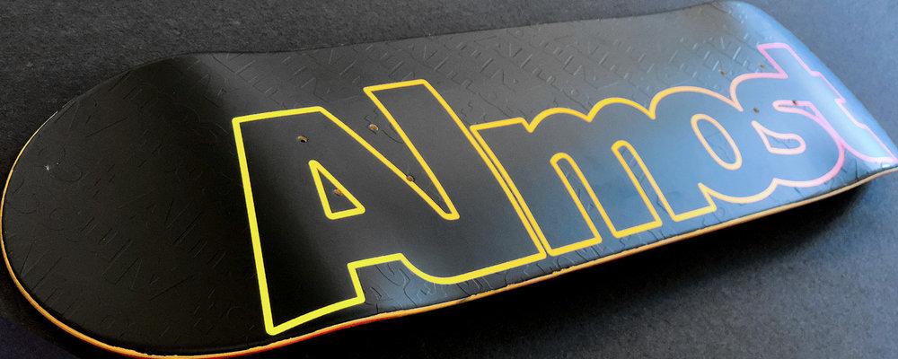 Almost og logo board embossed skateboard.jpg