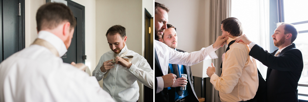 groom tying tie at the press hotel in portland maine