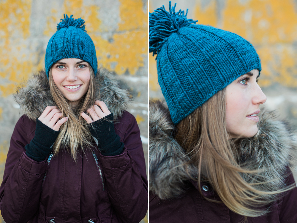 hand knit blue winter hat with pom pom on model in south portland, maine