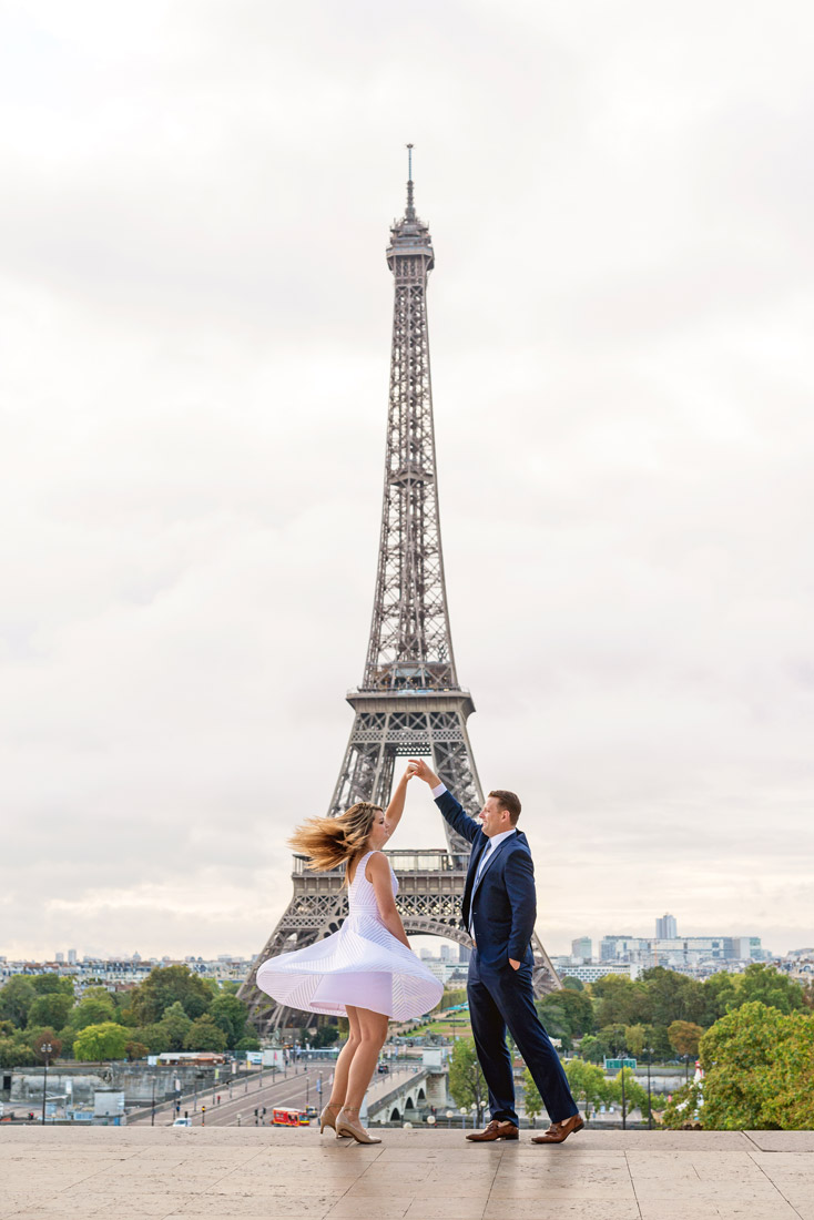 Photographer-Paris-Christian-Perona-proposal-engagement-dancing-Trocadero-Eiffle-tower-sunrise-white-dress-blue-navy-suite.jpg