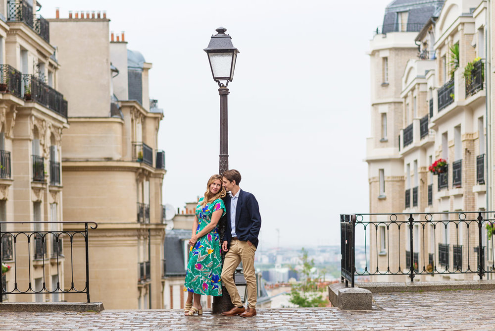 Paris-photographer-Christian-Perona-engagement-she-said-yes-love-Montmartre-cobblestones-street-green-dress-.jpg