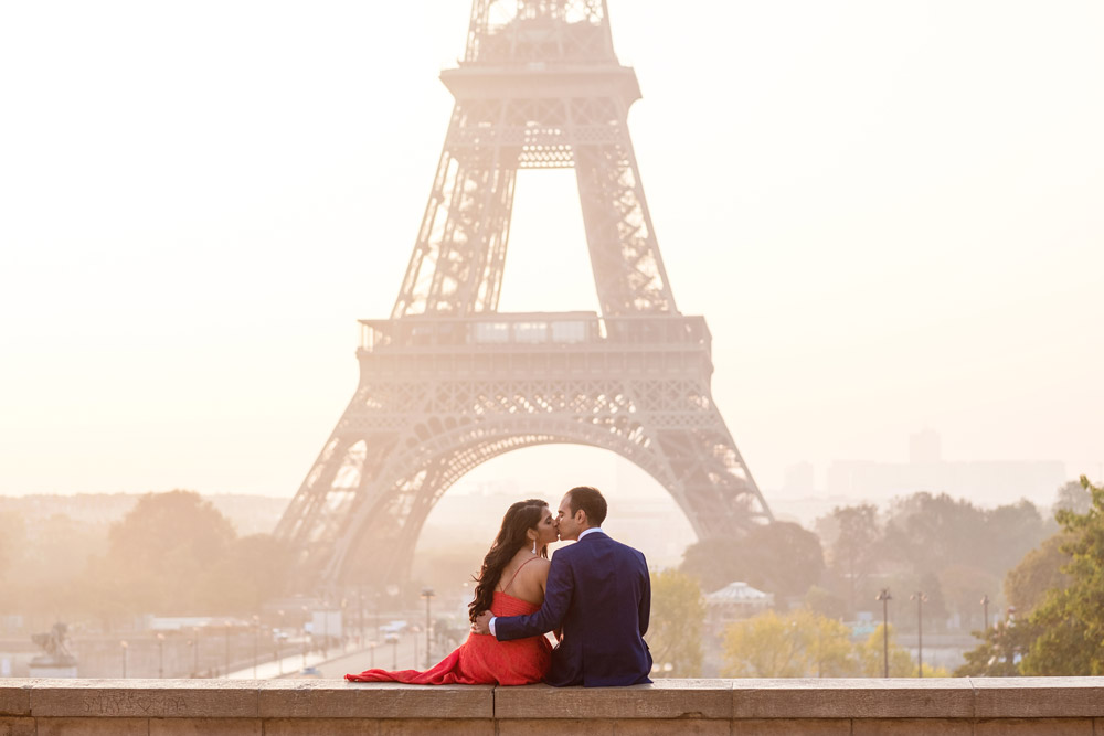 Paris-photographer-Paris-for-Two-Christian-Perona-professional-engagement-proposal-pre-wedding-portrait-Eiffel-tower-golden-hour-sunrise-red-dress-kissing-Trocadero.jpg