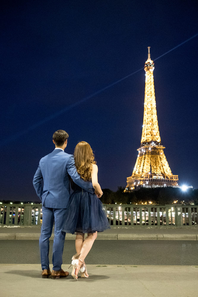 Paris-photographer-Paris-for-Two-Christian-Perona-engagement-blue-dress-love-pre-wedding-proposal-blue-hour-Eiffel-tower-night-shoot-pshotoshoot-sparkling-lit-light-Bir-Hakeim-bridge.jpg