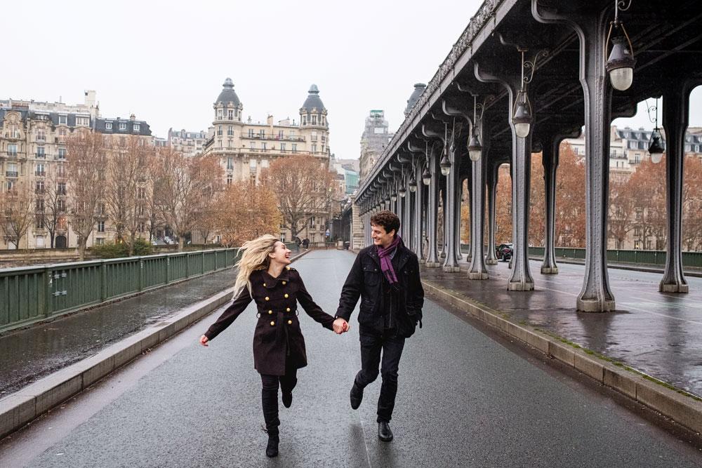 Paris-photographer-Paris-for-Two-Christian-Perona-engagement-blue-dress-love-pre-wedding-proposal-rain-rainy-day-inception-shoot-photoshoot-Bir-Hakeim-bridge.jpg