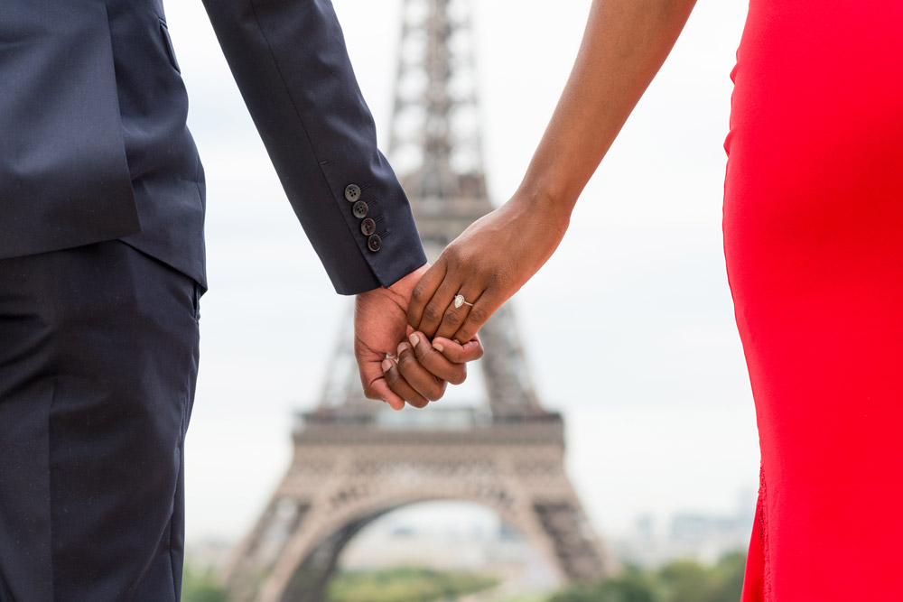 Engagement-Paris-photographer-Christian-Perona-sunrise-Trocadero-Eiffel-tower-she-said-yes-wedding-ring-blue-red-navy-suite-dress.jpg