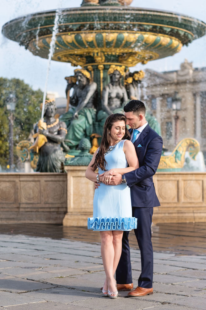 Paris-for-Two-Christian-Perona-engamement-proposal-she-said-yes-photoshoot-Place-de-la-Concorde-water-fountain-blue-dress.jpg