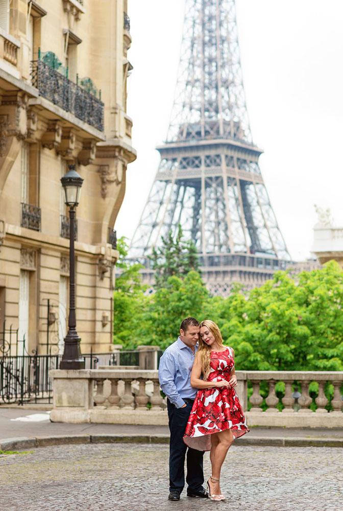 Paris-photographer-Christian-Perona-engagement-romantic-trip-love-red-dress-avenue-Camoens-cobblestones-street.jpg