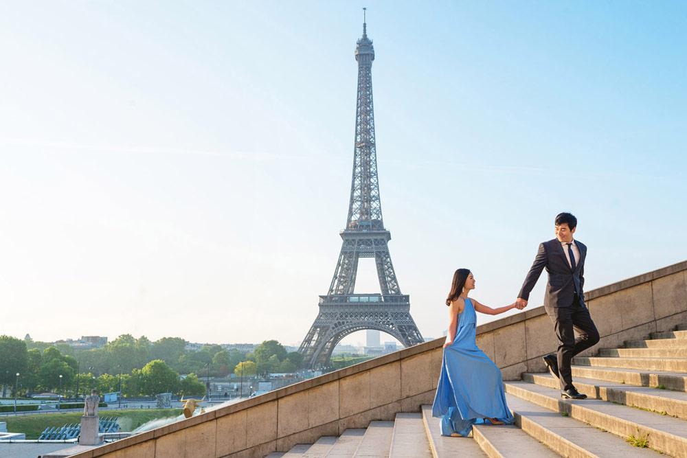 Proposal-photographer-in-Paris-Christian-Perona-proposal-engagement-sunrise-Trocadero-Eiffel-tower-she-said-yes-wedding-couple-stairs-blue-dress.jpg