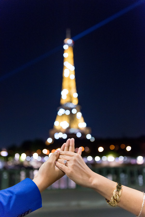 Paris-photographer-Paris-for-Two-Christian-Perona-engagement-blue-dress-love-pre-wedding-ring-proposal-blue-hour-Eiffel-tower-night-shoot-pshotoshoot-sparkling-lit-light-Bir-Hakeim-bridge.jpg