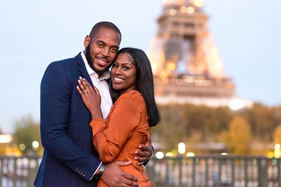Paris-photographer-Paris-for-Two-Christian-Perona-wedding-ring-portrait-engagement-orange-dress-love-proposal-she-said-yes-romantic-photoshoot-Bir-Hakeim-bridge-sunset-Eiffel-tower.jpg