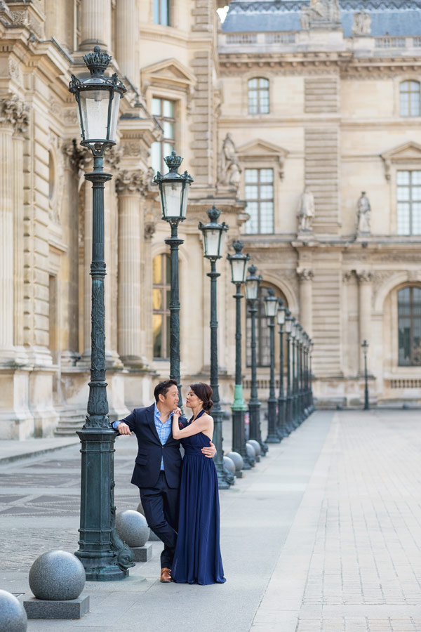 Paris-for-Two-Christian-Perona-Louvre-Museum-Musee-Paris-photographer-proposal-engagement-pre-wedding-honeymoon-love-romantic-lamps-blue-dress.jpg
