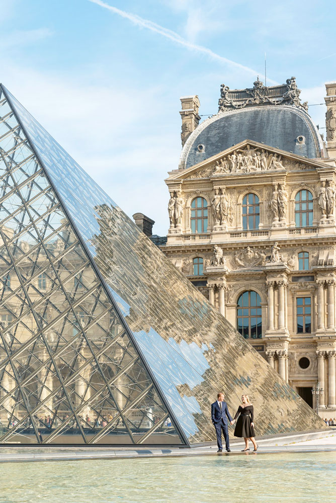 Paris-photographer-Paris-for-Two-Christian-Perona-Proposal-engagement-he-asked-she-said-yes-Louvre-museum-pyramid-sunrise-reflection-hand-to-hand.jpg
