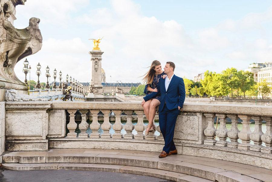 Paris-photographer-Christian-Perona-couple-engagement-proposal-pont-Alexander-Alexandre-III-bridge-golden-statue-seating-blue-navy-suite.jpg
