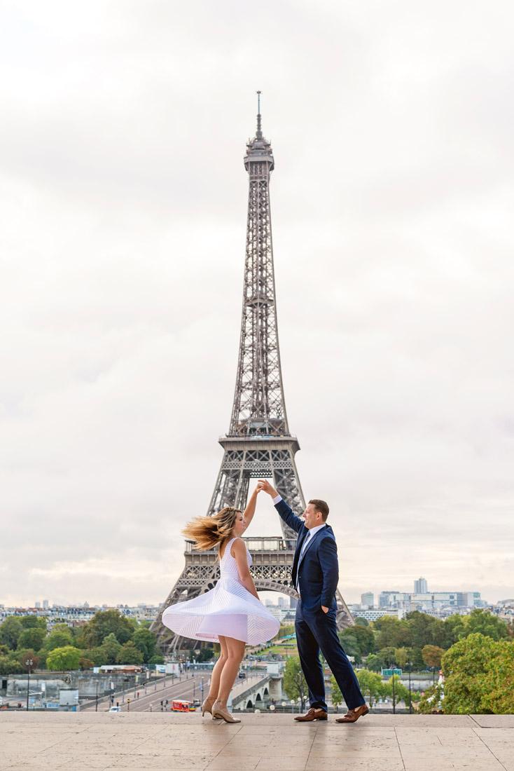 Photographer-Paris-Christian-Perona-proposal-engagement-dancing-Trocadero-Eiffle-tower-sunrise-white-dress-blue-navy-suite.jpg