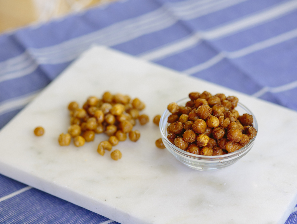 Spicy roasted chickpeas on the right; salt and vinegar roasted chickpeas on the left.