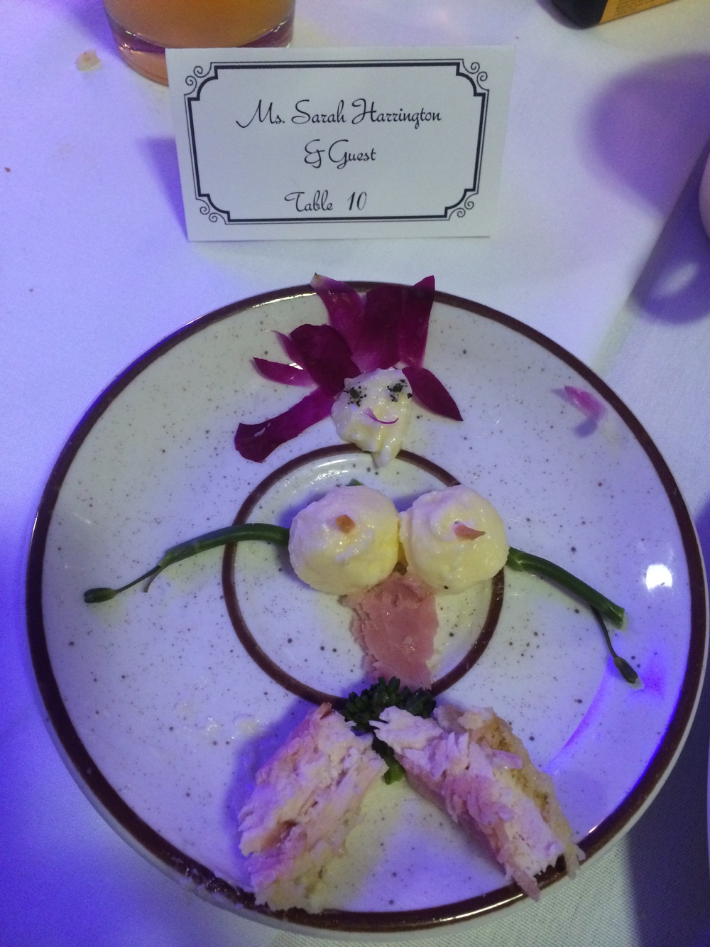 "I'm not all grown up... Here's my entry to a (very entertaining) ""Food Face"" competition at the first wedding. She's got black pepper irises, broccolini pupils AND bush, meaty chicken and ham thighs, hair of flower garnish and butter ball boobies. My parents really got to see my degree in action with this."