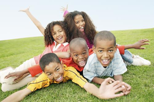 happy_kids_on_the_grass_jpg.jpg