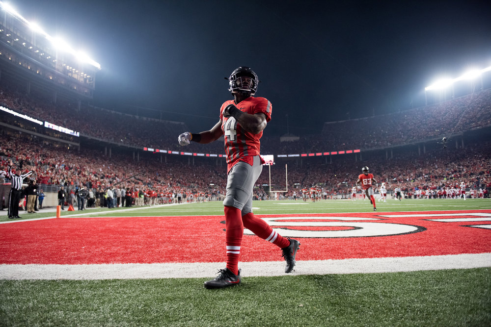 Curtis Samuel (4) celebrates in the end zone after scoring a 75-yard touchdown against #10 ranked Nebraska on November 6, 2016 in Ohio Stadium. Ohio State won 62-3 in front of 108,000 fans behind Samuel's 178 yards from scrimmage and two touchdowns.