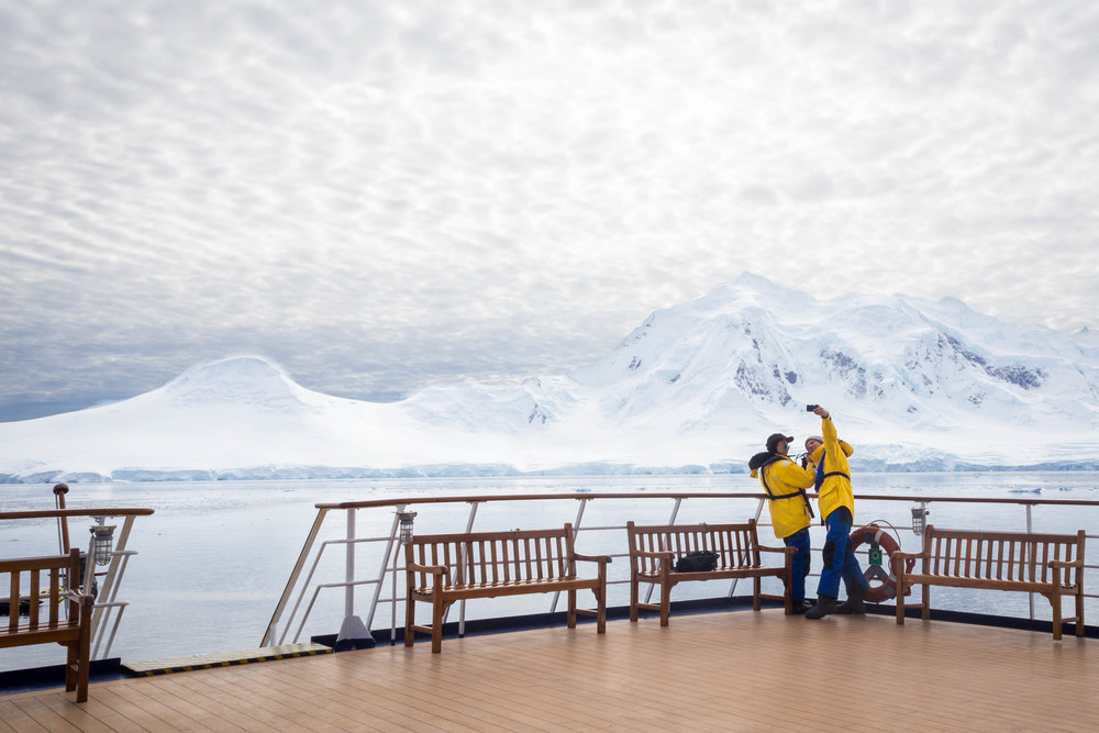 Justin and Minh take a selfie in the Neumeyer Channel, approaching Port Lockroy.