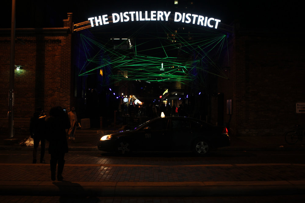 Entrance to The Distillery District with neon rope.