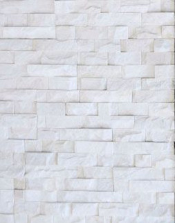 Stone cladding or veneer. Real stone's adopted-out illegitimate love child
