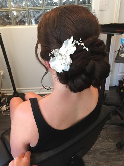 I have some extra hair pieces in the studio for brides to try on and get ideas for what they may want. This is one style that I recommended for Kristin's particular updo.