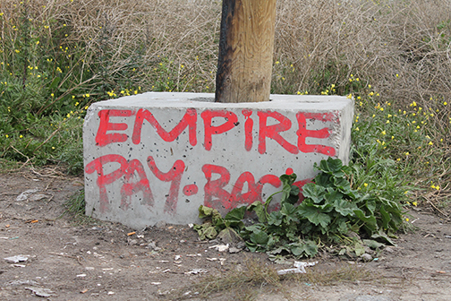 performance and protest Empire pay back.jpg