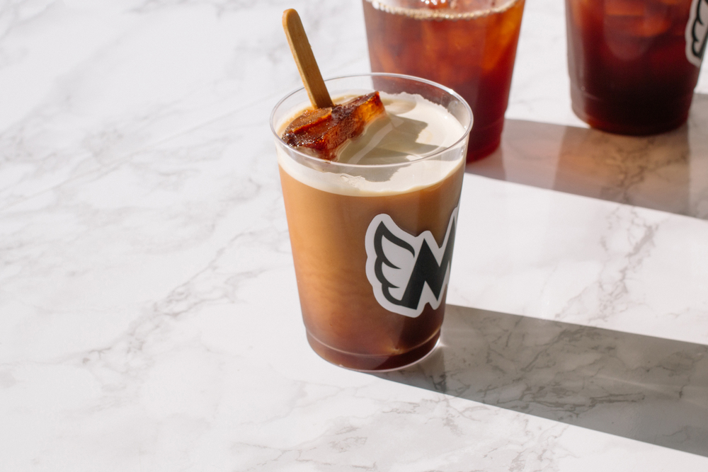 Nitro pops in cold brew at Mighty Brew Brothers