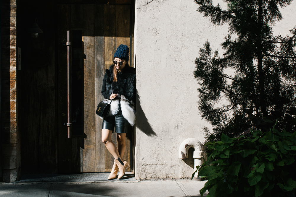 Ashley B Vest, Everlane Sweater, COS Shorts, Dear Frances Boots (in Caramel), Céline Bag, & Other Stories Hat, Dior Sunglasses