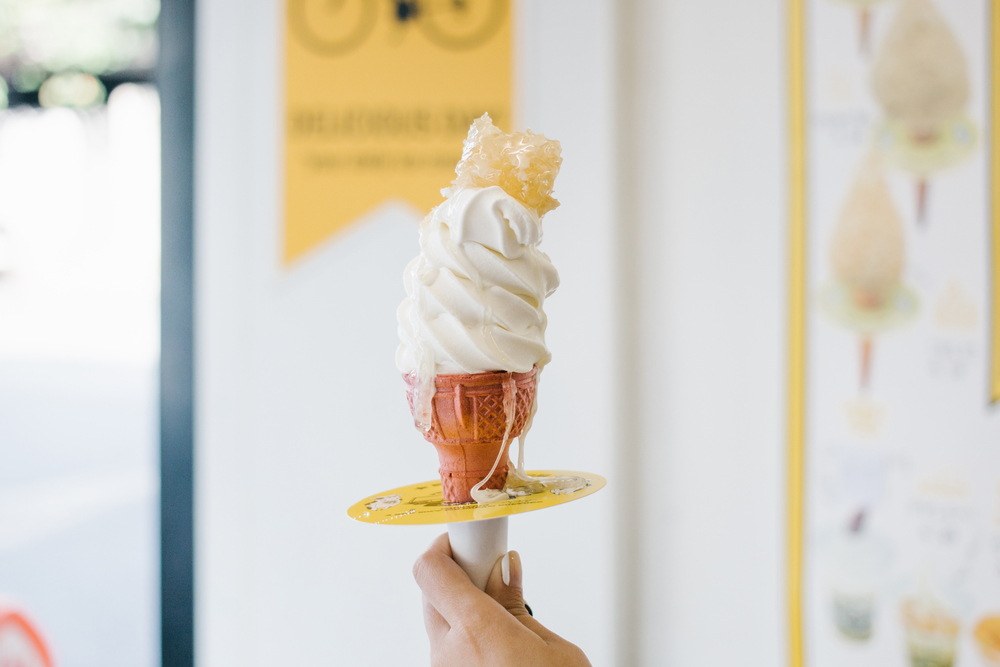 Milk soft serve with honey comb on top at  소프트리 (SOFTREE)